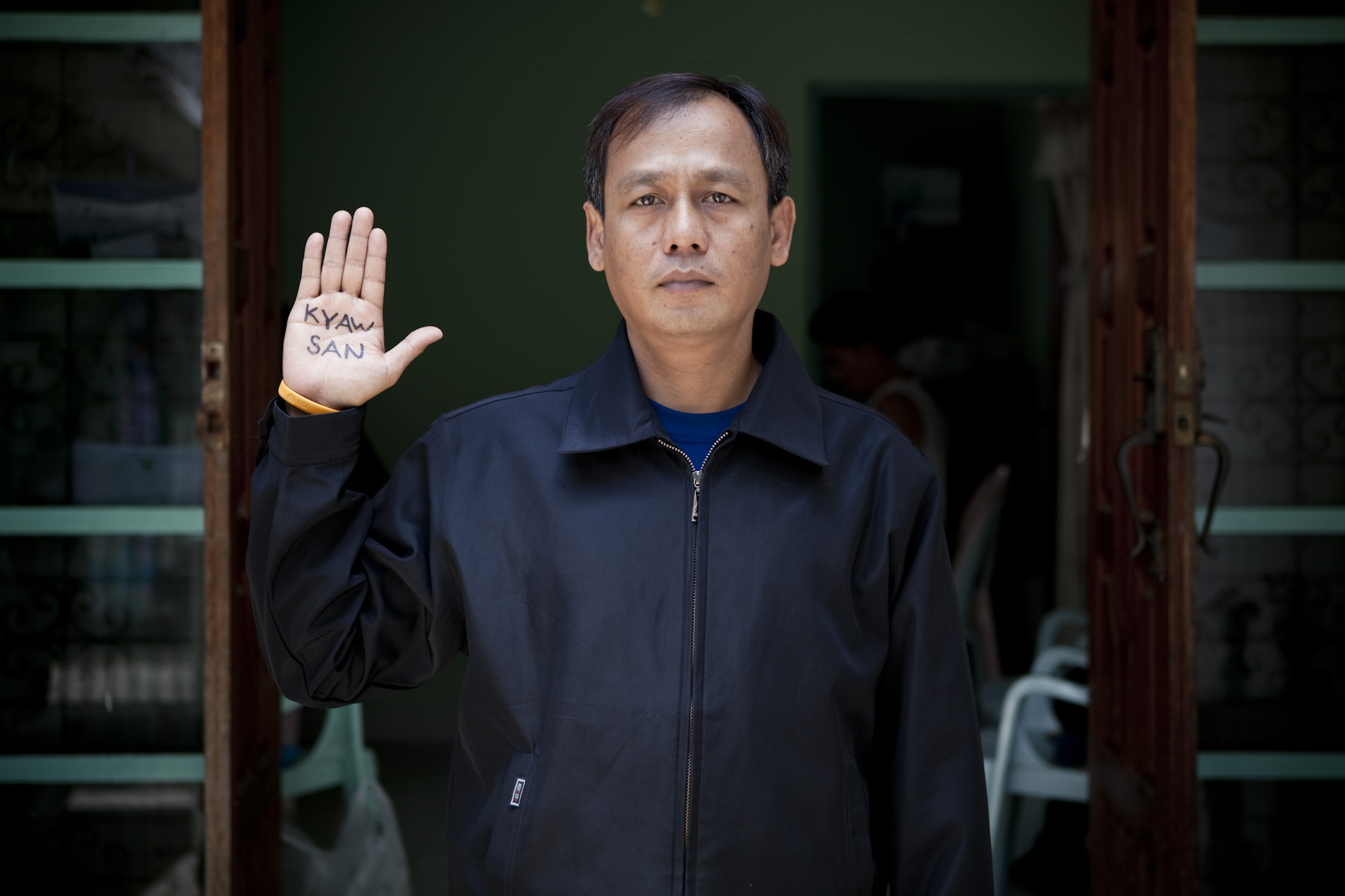 "Burma's former political prisoners from across the world demanded the release of all political prisoners currently incarcerated in Burma's prisons. This is Phone Myint Tun. He was jailed for 4 years in Insein prison. This image is taken from the documentary project ""Even Though I'm Free I Am Not"". (Image Copyright ENIGMA IMAGES /  enigmaimages.net)"