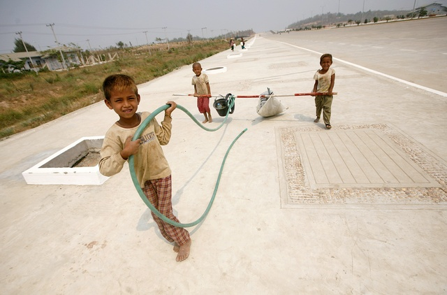 A file photo of children carrying construction equipment in Naypyidaw in 2010. (PHOTO: Reuters)