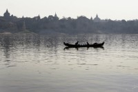A file photo of fishermen tending their nets on the Irrawaddy River with the ancient temples of Bagan in the background. (PHOTO: Reuters)