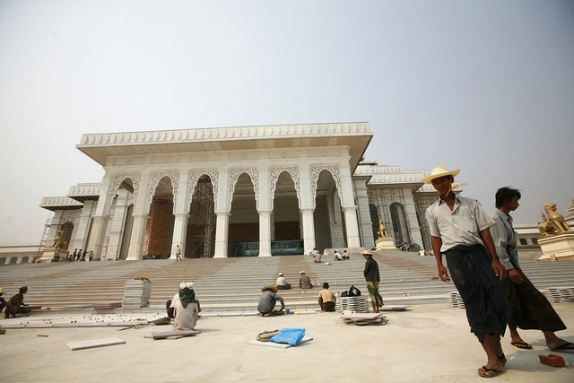 Workers are seen near Myanmar's new parliament building which is under construction in Naypyidaw