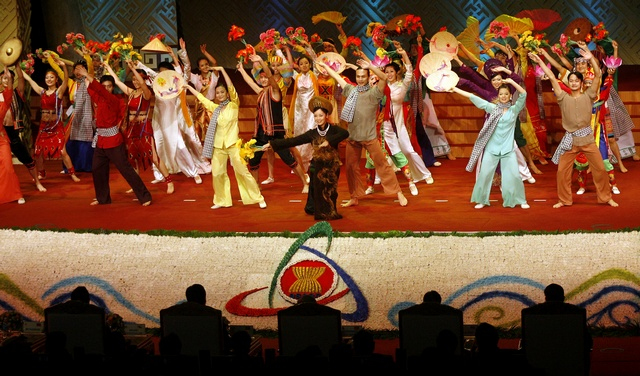 Vietnamese performers dance during the opening ceremony for the 16th ASEAN Summit in Hanoi
