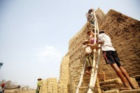 A long way to go - labourers carry bricks at a brick kiln near Hlawga, near Rangoon, in this 2010 file picture. (PHOTO: Reuters)