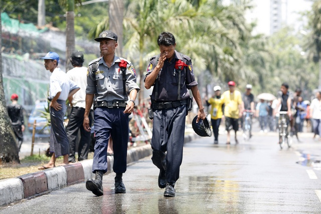 A file photo shows sodden police officers patrolling the streets during Thingyan. (Photo: Reuters)