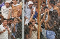 Migrant workers held at a detention centre in Malaysia for having no work permits or legal documents, 2010. (PHOTO: DVB)