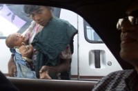 A child begs on the streets of Rangoon.