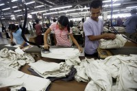 Garment workers at a foreign-owned factory in Rangoon. (Photo: DVB)