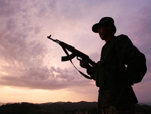 The silhouette of a Shan State Army - South soldier.