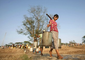 File photo of people collecting water near Rangoon's Dala Township in May 2010. (Photo: Reuters)