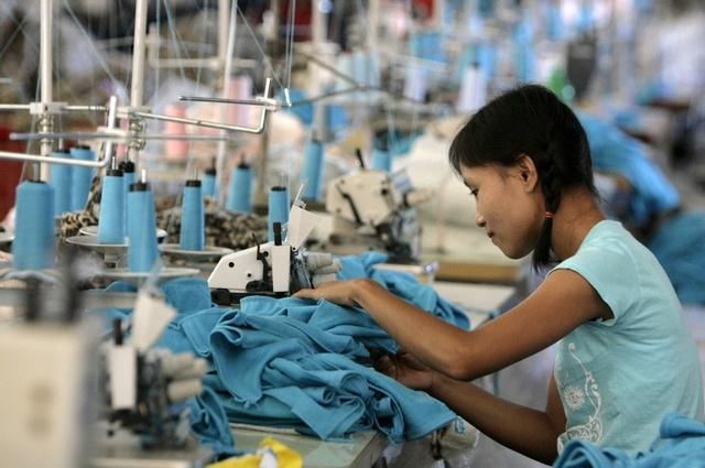 File photo of a Burmese worker in a garment factory in Mae Sot, Thailand. (PHOTO: Reuters)