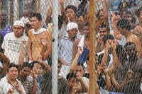 FILE {PHOTO: Migrant workers held at a detention centre in Malaysia for having no work permits or legal documents, 2010. (PHOTO: DVB)