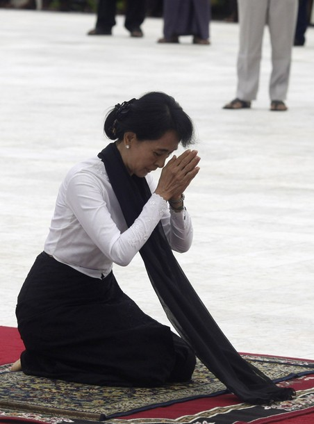 Myanmar's pro-democracy leader Aung San Suu Kyi prays at an event marking the anniversary of Martyrs' Day at the Martyrs Mausoleum in Yangon