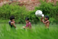 In this file photo from 2009, Rohingya children bathe at a pond in a Cox's Bazaar refugee camp. (PHOTO: Reuters)