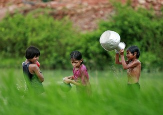 Rohingya children from Burma bathe at a pond in a Cox's Bazaar refugee camp in 2009. (Reuters/Andrew Biraj)