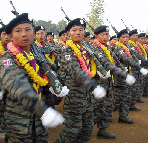 Military personnel from the Democratic Karen Buddhist Army (DKBA), an ethnic militia battling Myanmar's military junta, take part in a traditional New Year's parade on the Myanmar-Thai border