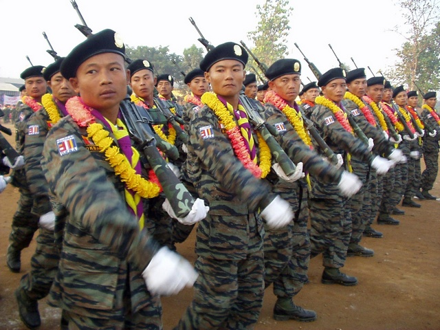 Troops from the Democratic Karen Buddhist Army (DKBA) take part in a traditional New Year's parade on the Thai-Burma border. (Reuters)