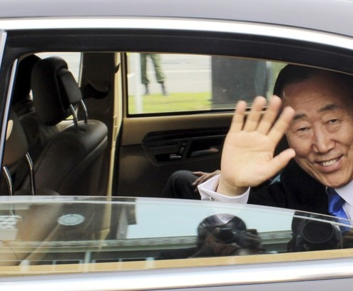 United Nations Secretary General Ban Ki Moon waves as his motorcade leaves the Kenneth Kaunda International Airport for the National Assembly where he later addressed the Zambian Parliament in Lusaka