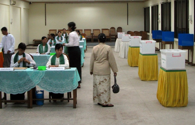Officials and citizens at a polling station in central Rangoon during elections on November 7, 2010. (Reuters)