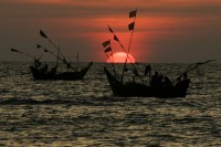 In this file photo, fishing boats are seen against the setting sun near Tavoy [Dawei] in southern Burma. (PHOTO: Reuters)