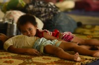 Two Kachin children displaced by fighting shelter in the KIA headquarters of Laiza (Ryan Libre / DAA)