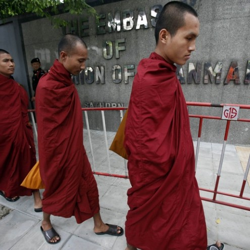 Myanmarese monks, living in Thailand, walk outside the Myanmar Embassy during a rally calling for Suu Kyi's release, in Bangkok