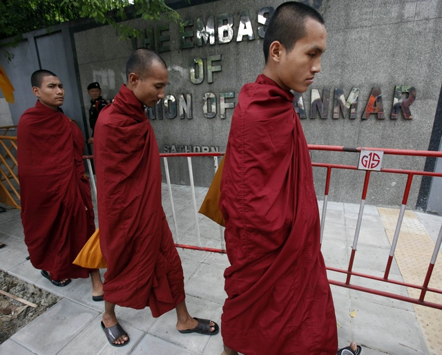 Burmese monks, living in Thailand, walk outside the Burmese Embassy in Bangkok call for the release of political prisoners in 2009. (Reuters)