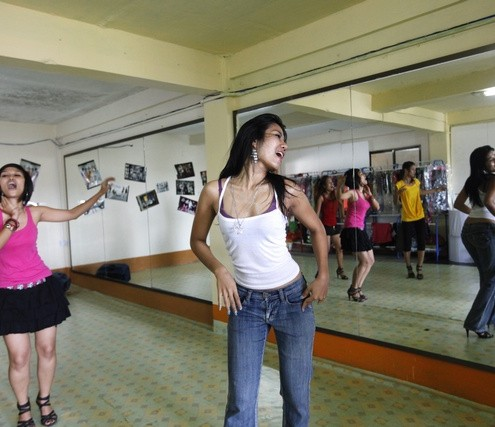 Members of the Tiger Girls band rehearse for their upcoming live concert in their studio at Yangon