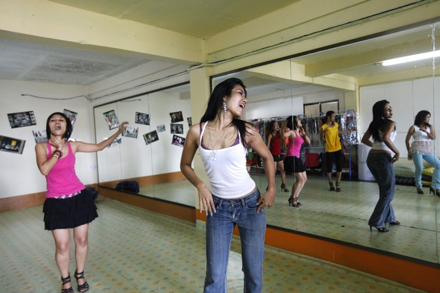 Members of the Tiger Girls, Electro Tiger (L) and Missy Tiger, rehearse before a concert in their studio in Rangoon on September 17, 2010. (Reuters)