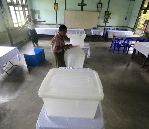 Election staff set up a ballot station in Yangon
