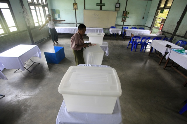 Election staff set up a ballot station in Rangoon on 31 March 2012. (Reuters)