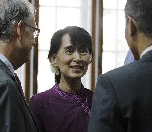 Myanmar pro-democracy leader Aung San Suu Kyi talks with guests during the opening ceremony of the European Union Office at Yangon
