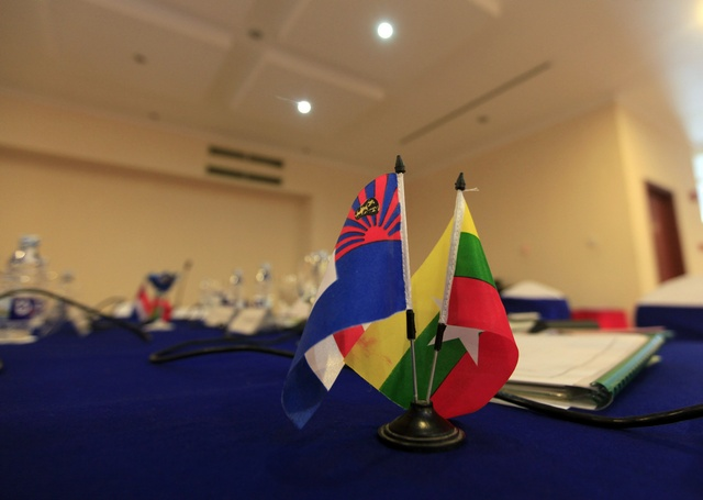 A Burmese national flag (R) and a flag of the Karen nation are seen on a meeting table before the Karen National Union and the Union Peace Committee meet at Sedona hotel in Rangoon on 6 April 2012. (Reuters)