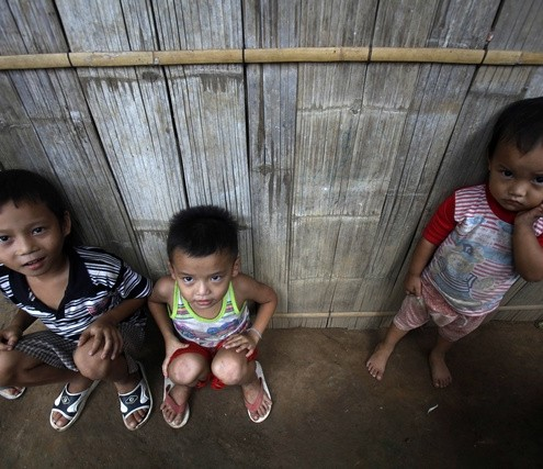 Ethnic Karen refugee children sit in Mae La refugee camp, outside Mae Sot district near the Thai-Myanmar border