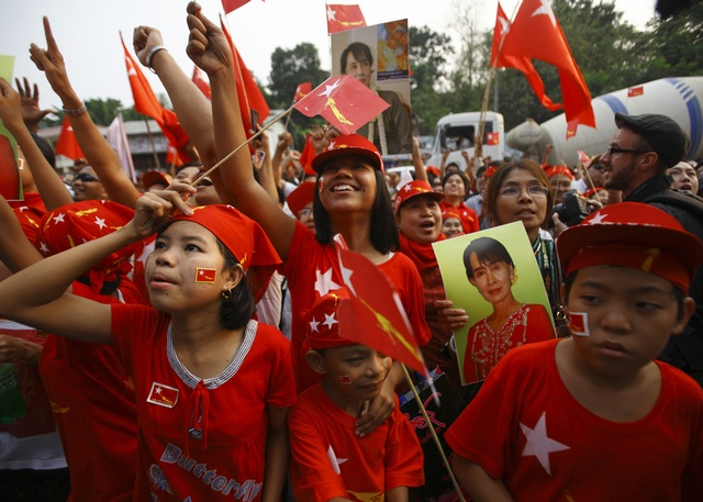 Young NLD supporters cheer as they watch increasing votes on a screen on the roof of the party headquarters in Rangoon during by-elections in April 2012. (PHOTO: Reuters)