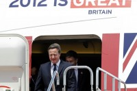 Britain's Prime Minister David Cameron (L) arrives at Haneda airport in Tokyo on 10 April 2012. (Reuters)