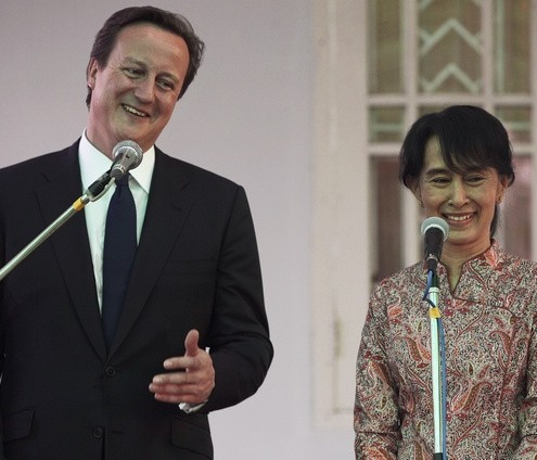 Britain's PM Cameron and Nobel laureate Aung San Suu Kyi smile as they address reporters at her residence in Yangon