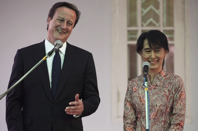 Britain's PM Cameron and Nobel laureate Aung San Suu Kyi address reporters at her residence in Rangoon (Reuters)