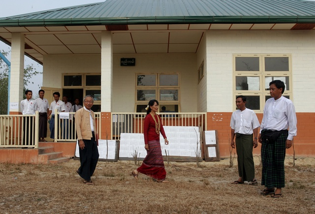Aung San Suu Kyi visits a polling station in Kawhmu township on 1 April 2012, where she stands as a candidate in parliamentary by-elections. (Reuters)