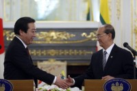 Japan's Prime Minister Yoshihiko Noda (L) shakes hands with Burma's President Thein Sein during a joint news conference following their bilateral meeting at the Japan-Mekong summit in Tokyo on 21 April 2012. Japan has since forgiven Burma's debt and is now preparing fresh loans to kick-start development projects in the country.(Reuters)