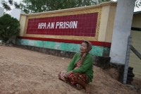 A family member of a political prisoner awaits his release in front of Pa-an prison on 13 January 2012. While a general amnesty in January saw the release of hundreds of dissidents, rights groups claim about 1,000 political prisoners are still behind bars. (Reuters)