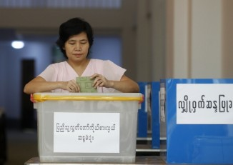 In this file photo, a woman votes at a ballot station during by-elections in Rangoon on 1 April  2012. (PHOTO: Reuters)