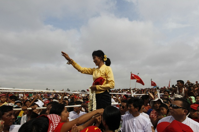 Aung San Suu Kyi gestures at her supporters to sit down during an entertainment show at a ceremony to mark Burma's New Year Day in her constituency of Kawhmu township on 17 April 2012. (PHOTO: Reuters)