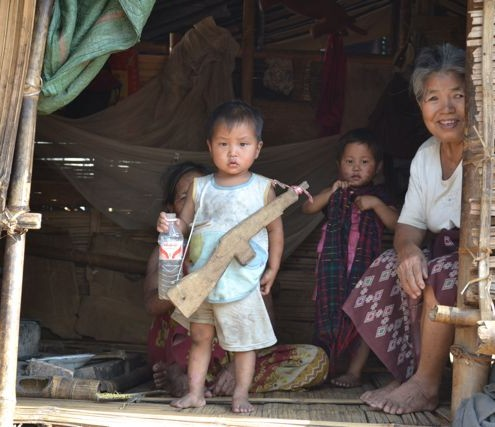 A Kachin child stands guards of his family&#039;s hut in Jeyang refugee camp in Laiza, Kachin state (Hanna Hindstrom)
