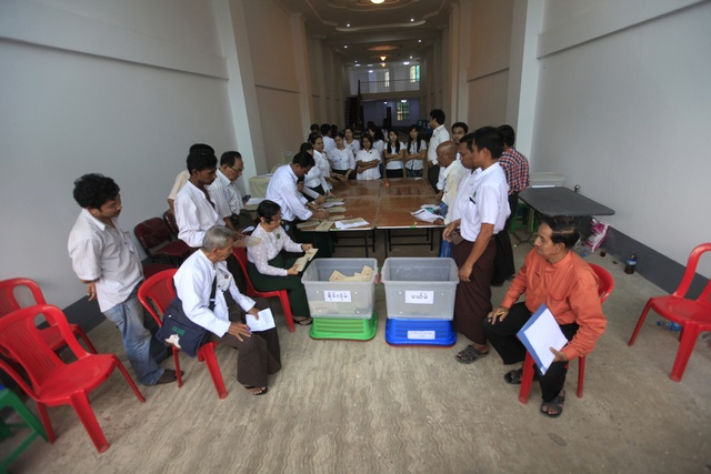FILE PHOTO: People count votes in a ballot station during by-elections in Rangoon on 1 April 2012. (Reuters)