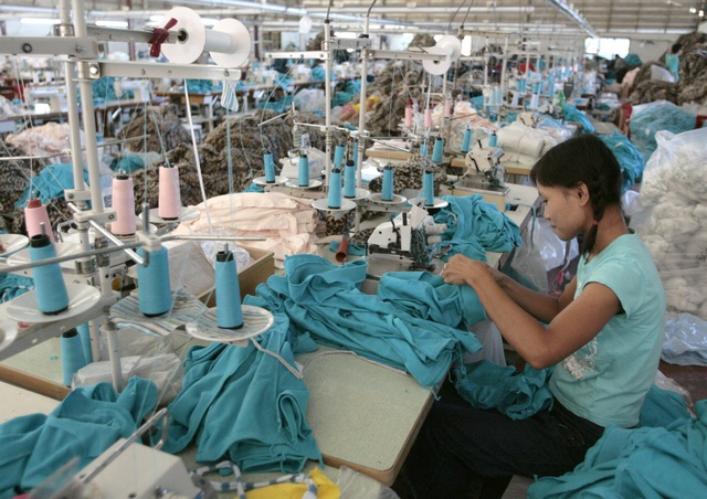 A Burmese migrant works in a Taiwan-owned garment factory in the northwestern Thai town of Mae Sot. Despite labour laws guaranteeing migrant workers basic rights such as a standard eight-hour working day, paid overtime and a minimum wage, the regulations are universally flouted. (Photo: Reuters)