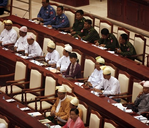 Myanmar pro-democracy leader Aung San Suu Kyi attends a parliament meeting in the lower house of parliament at Naypyitaw