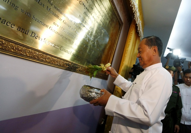 Vice President Tin Aung Myint Oo sprinkles fragrant water at a plaque during the opening ceremony of a children's hospital in Rangoon on 13 March 2011. (Reuters)