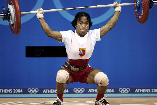 File photo of Burma's Nan Aye Khine competing in the 48 kg weightlifting category at the Athens 2004 Olympic Games. (Reuters)