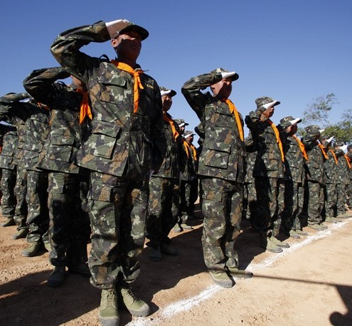 Shan State Army (SSA) soldiers salute during the 65th anniversary of Shan State National Day at the army's Loi Taileng headquarters in Shan State along the Myanmar-Thai border