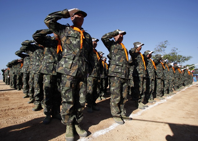 Shan State Army (SSA) soldiers salute during the 65th anniversary of Shan State National Day at the army's Loi Taileng headquarters in Shan State along the Burma-Thai border on 7 February 2012. (Reuters)
