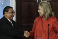 US Secretary of State Hillary Clinton (R) shakes hands with Burma's Foreign Minister Wunna Maung Lwin after their meeting at the State Department in Washington on 17 May 2012. (Reuters)